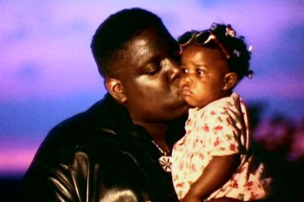 Notorious B.I.G. and daughter Tyanna.