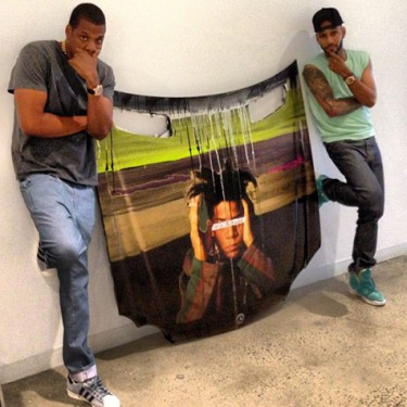 Jay-Z buys Swizz Beatz art piece.