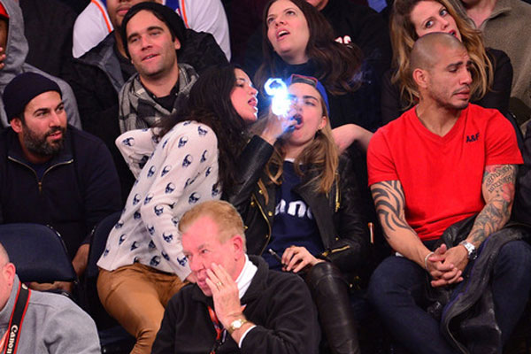 Drunk Michelle Rodriguez Spotted All Over Cara Delevingne at Knicks game
