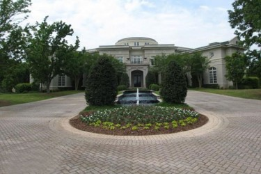 Rick Ross buys Evander Holyfield's Georgia mansion