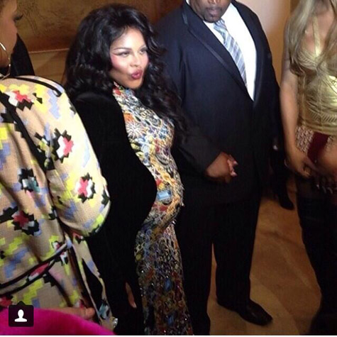 Lil Kim pregnant at New York Fashion Week