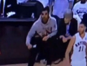 Drake using lint roller courtside at the Raptors game.