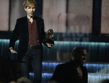 Kanye West jokingly crashes Grammys stage as Beck takes home Album of the Year