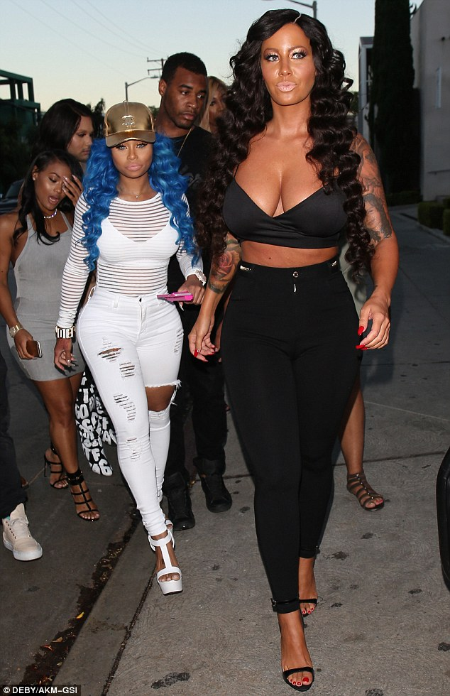 Amber Rose Nearly Unrecognizable In Drake Curly Wig