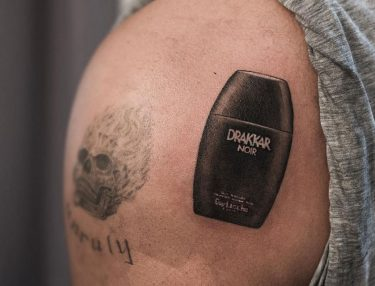 Drake's new Drakkar Noir tattoo