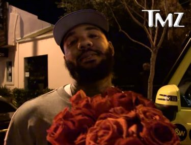 The Game offers roses to Nicki Minaj