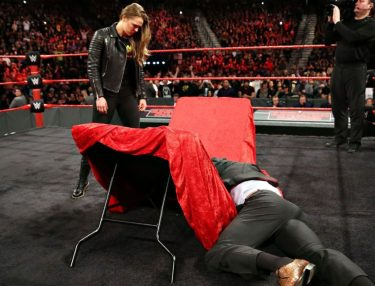 Ronda Rousey Puts Triple H Through a Table at Contract Signing