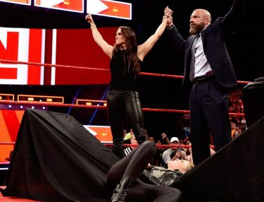 Stephanie McMahon Puts Ronda Rousey Through Table